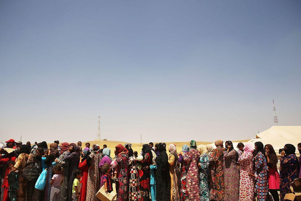 Many of the city's residents flee to the neighboring Kurdish region.