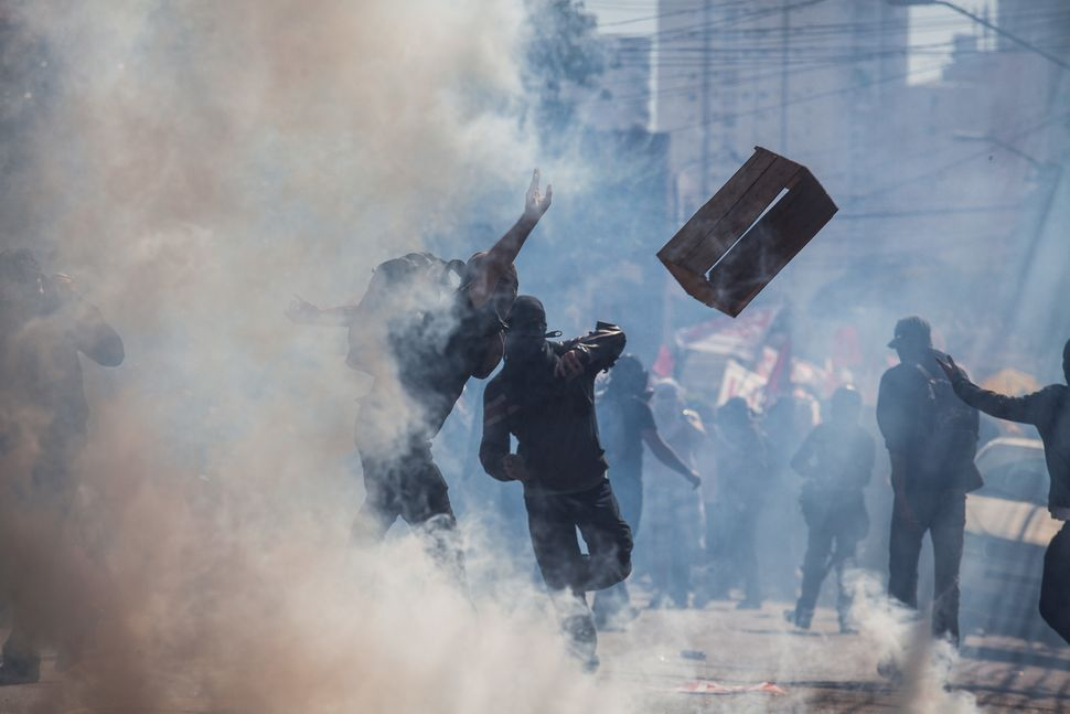 "The games are preceded by massive protests. The protesters <a href=""http://www.telegraph.co.uk/news/picturegalleries/worldnew"