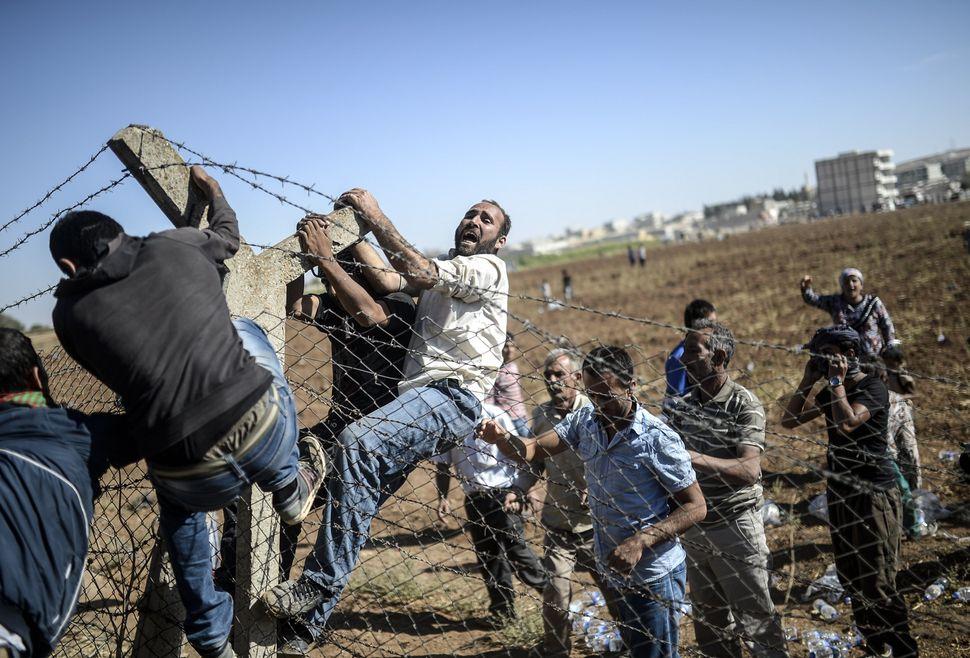 "The Islamic State <a href=""http://www.theatlantic.com/infocus/2014/10/the-battle-for-kobani/100828/"" target=""_blank"">besieges"