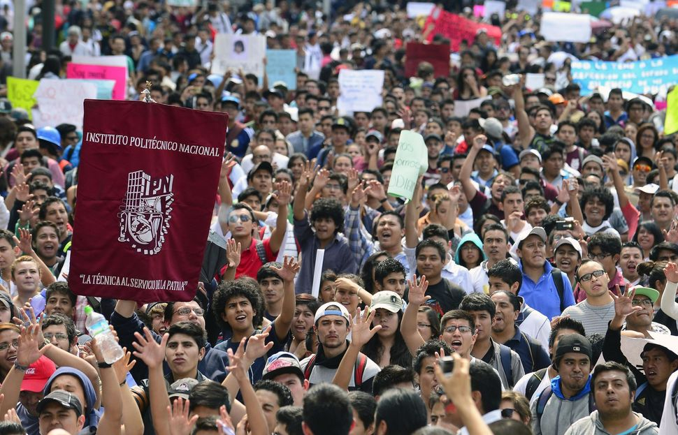 Thousands of Mexicans take to the streets in the wake of the tragedy, demanding police reforms and new measures against corru