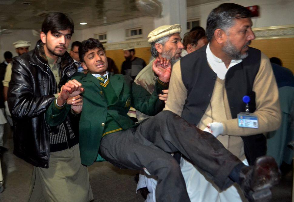 "Taliban fighters <a href=""https://www.huffpost.com/entry/pakistan-taliban-school-attack_n_6334224?utm_hp_ref=world"" target=""_"
