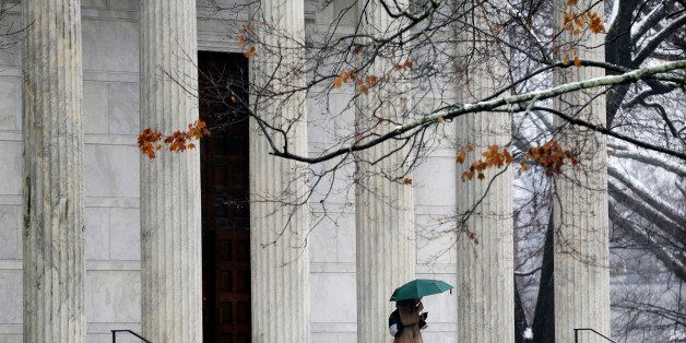 A person walks with an umbrella at Princeton University in Princeton, N.J., Monday, Dec. 9, 2013. The Ivy League school has b