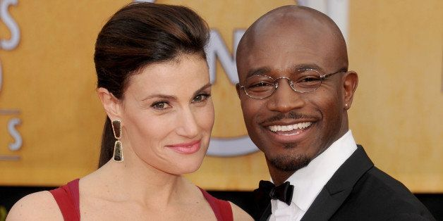 LOS ANGELES, CA - JANUARY 27: Actors Idina Menzel and Taye Diggs arrive at the 19th Annual Screen Actors Guild Awards at The