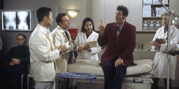 SEINFELD -- 'The Burning' Episode 16 -- Pictured: (l-r) Daniel Dae Kim as Student, (second from right) Michael Richards as Co
