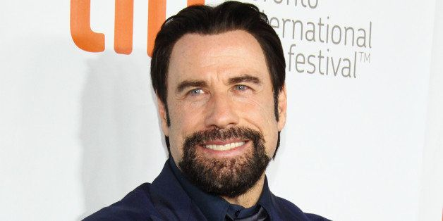 TORONTO, ON - SEPTEMBER 12:  Actor John Travolta arrives at 'The Forger' Premiere during the 2014 Toronto International Film