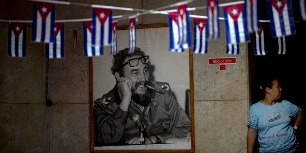 A photograph Fidel Castro hangs in a municipal building where miniature Cuban flags decorate the entrance in Havana, Cuba, Fr