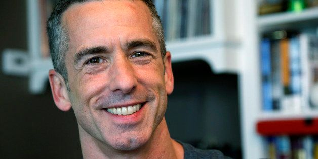 "In this photo taken on May 22, 2013, author Dan Savage is in his home in Seattle. Savage's latest book, ""American Savage,"" wa"