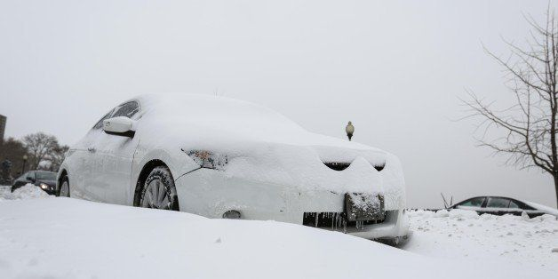 NEW YORK, NY - JANUARY 27: A car is covered with the snow after a major snow storm January 27, 2015 in New York, United State