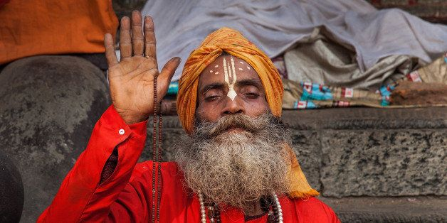 KATHMANDU, NEPAL - FEBRUARY 17:  A Shadu, or holy man, prays inside Pashupatinath temple during the celebration of the Maha S