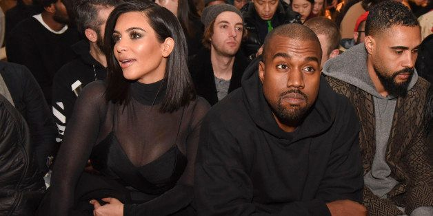 NEW YORK, NY - FEBRUARY 14:  Kim Kardashian and Kanye West attend the Robert Geller show during Mercedes-Benz Fashion Week Fa