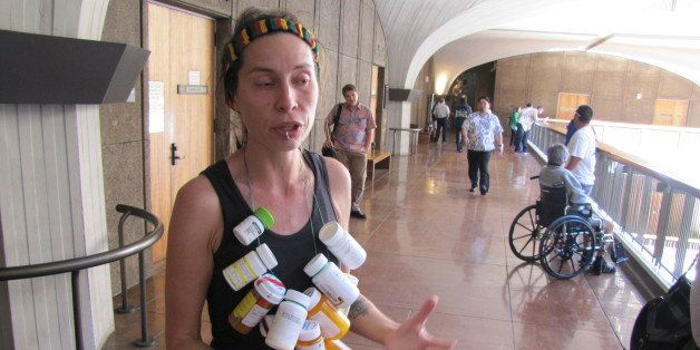 Michelle Tippens, of Honolulu, talks about the need for medical marijuana dispensaries at the Hawaii Legislature, Tuesday, Fe