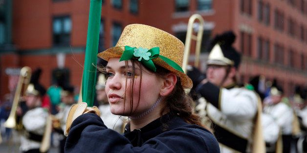 BOSTON - MARCH 15: A member of the Lapel High School Marching Band and Guard marches during the St. Patrick's Day Parade in t