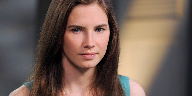 This April 9, 2013 photo released by ABC shows Amanda Knox, left, speaking during a taped interview with ABC News' Diane Sawy