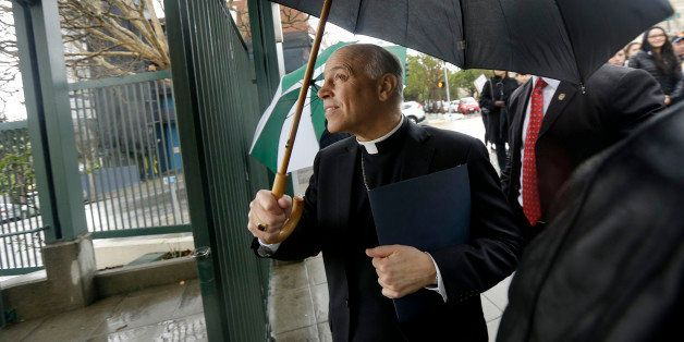 Salvatore Cordileone, the Roman Catholic archbishop of San Francisco, walks through a gate to Sacred Heart Cathedral Preparat
