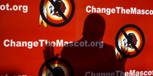The shadow of Del. Eleanor Holmes Norton, D-D.C., is cast on the backdrop during the Oneida Indian Nation's Change the Mascot