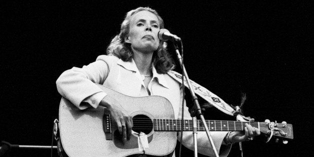 LONDON - SEPTEMBER 14: Joni Mitchell performs live on stage at Wembley Stadium, London on 14th September 1974. (Photo by Gijs