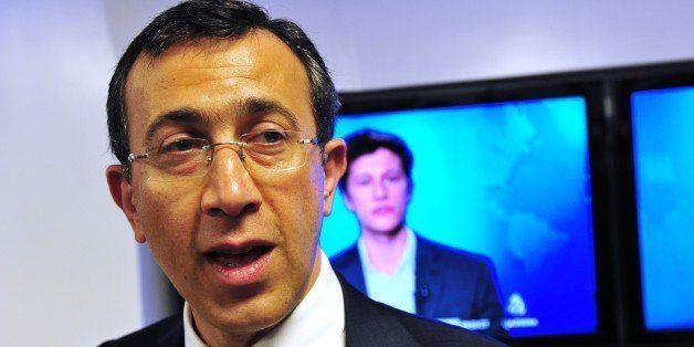 Al Jazeera Americas CEO Ehab Al Shihabi speaks to journalists in the lobby of the new Al Jazeera America television broadcast