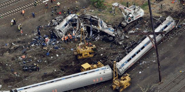Emergency personnel work at the scene of a deadly train derailment, Wednesday, May 13, 2015, in Philadelphia. The Amtrak trai