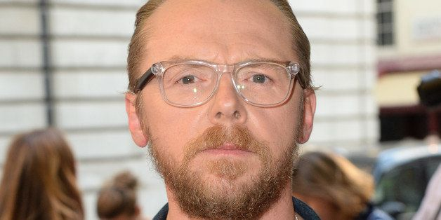 LONDON, ENGLAND - MAY 13:  (SUN NEWSPAPER OUT. MANDATORY CREDIT PHOTO BY DAVE J. HOGAN GETTY IMAGES REQUIRED) Simon Pegg atte