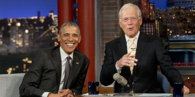 President Barack Obama with host David Letterman talk during a break at a taping of CBS' The Late Show with David Letterman a