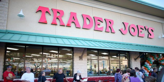 PINECREST, FL - OCTOBER 18: Shoppers lineup as they wait for the grand opening of a Trader Joe's on October 18, 2013 in Pinec