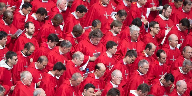 Prelates attend a Pentecost Mass , in St. Peter's Square at the Vatican, Sunday, May 19, 2013. (AP Photo/Andrew Medichini)