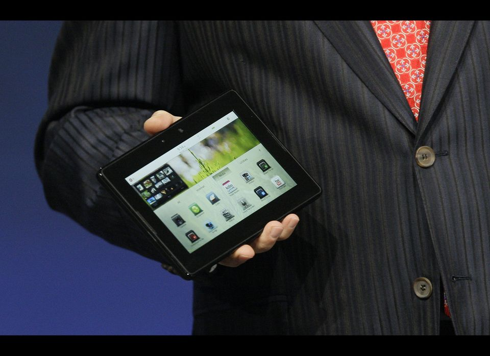 Mike Lazaridis, president and co-CEO of Research in Motion Ltd. (RIM), holds the new PlayBook during the BlackBerry developer