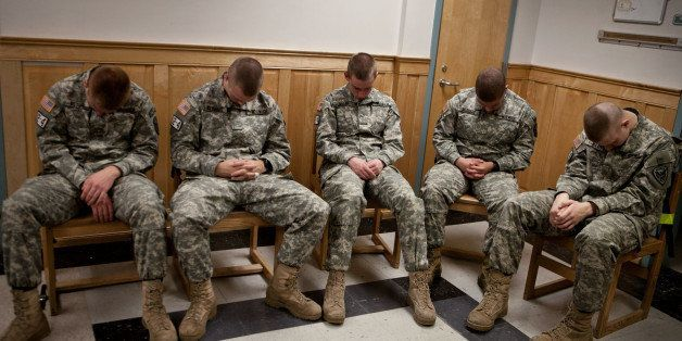 NORTHFIELD, VT - NOVEMBER 26: Left to right, Freshman Corps of Cadet Recruits Lance Ostby, Rob Wetmore, Matt Miller, Aaron McDuffie, and Jeremy Ward practice mediation after afternoon classes. First year Norwich University Corps of Cadet Recruits in Platoon 12-4-3 train in Transcendental meditation as part of ongoing research sponsored by the David Lynch Foundation's Operation Warrior Wellness program. The goal of the Transcendental Mediation training is to prevent PTSD by providing coping tools before exposure to combat or stressful situations. The platoon meditates every day, in the morning and evening, for 20 minutes. (Photo by Kayana Szymczak for The Boston Globe via Getty Images)