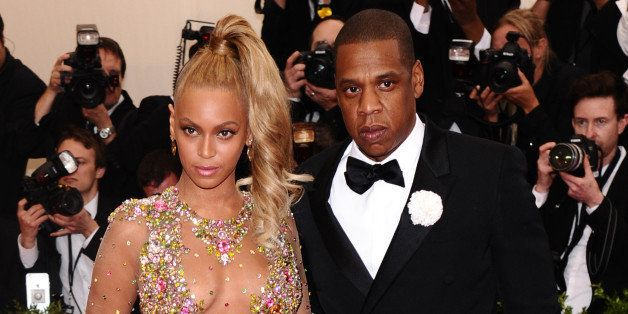 """Beyonce, left, and Jay-Z arrive at The Metropolitan Museum of Art's Costume Institute benefit gala celebrating """"China: Throug"""
