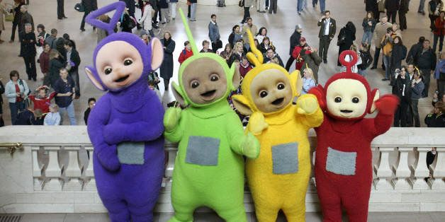 New York, UNITED STATES: The world famous Teletubbies (L-R) Tinky-Winky,Dipsy, Laa-Laa and Po pose on the balcony at Grand Ce