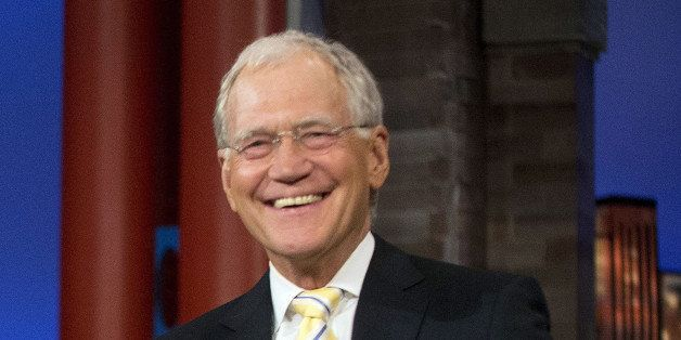 """FILE - In this May 4, 2015 file photo, host David Letterman smiles during a break at a taping of  """"The Late Show with David L"""