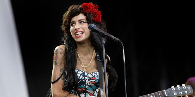 British singer, Amy Winehouse performs at the V Festival, near Chelmsford, England, Sunday, Aug. 17, 2008, after which, accor