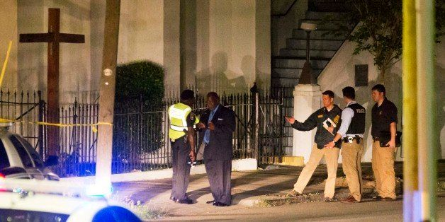 Police stand outside the Emanuel AME Church following a shooting Wednesday, June 17, 2015, in Charleston, S.C. (AP Photo/Davi