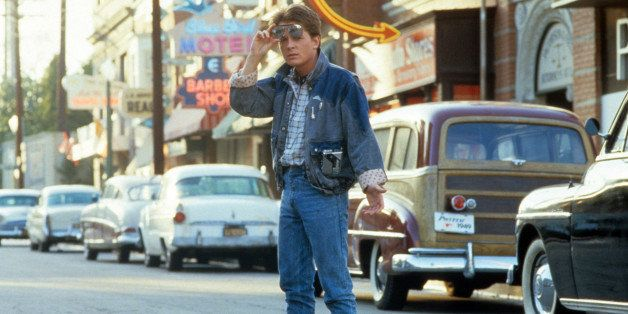 Michael J Fox walking across the street in a scene from the film 'Back To The Future', 1985. (Photo by Universal/Getty Images