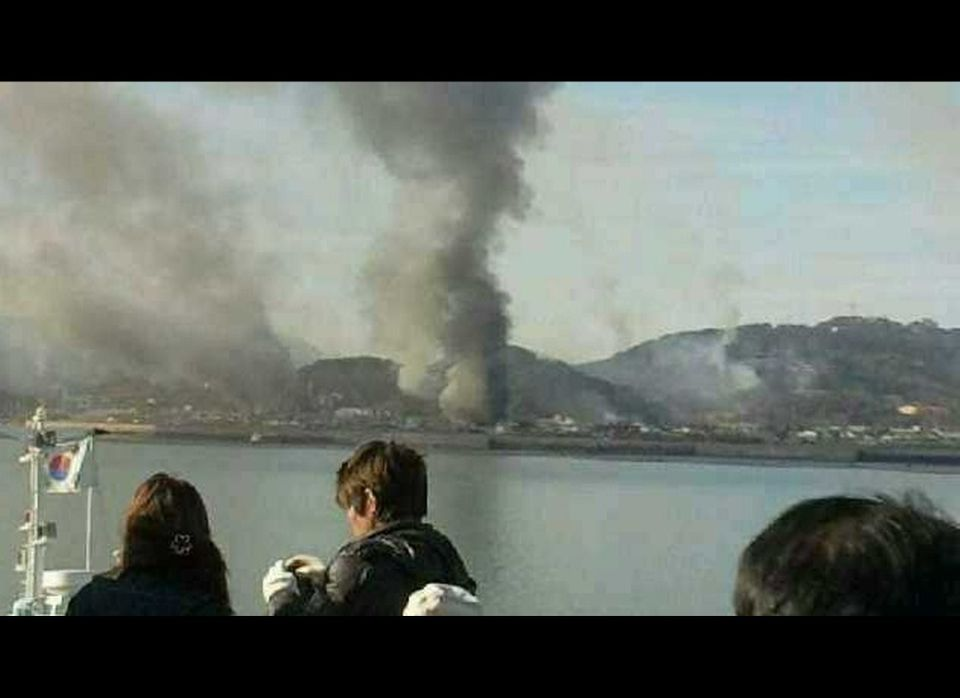 Smoke is seen at Yeonpyeong island near the border against North Korea, in South Korea.