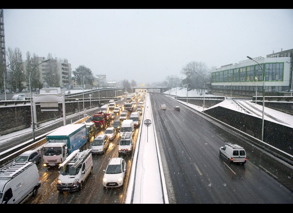 Vehicles are stuck in the Paris' ring due to heavy snow falls.