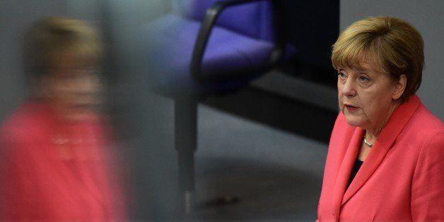 German Chancellor Angela Merkel addresses the Bundestag, the lower house of parliament in Berlin on September...