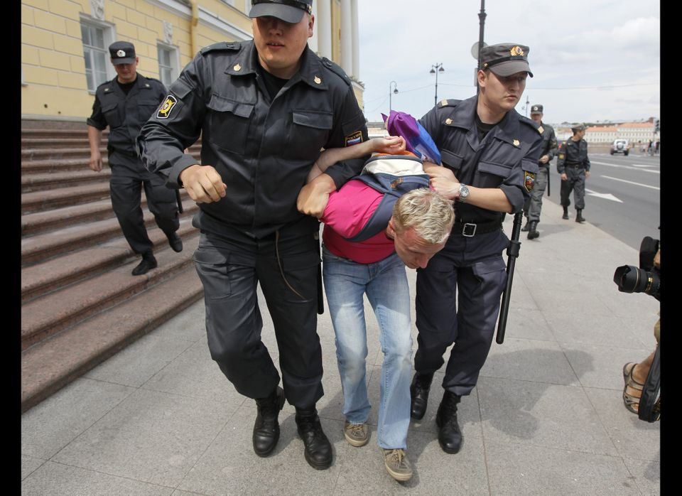 Police officers detain a gay rights activist during a St. Petersburg protest.