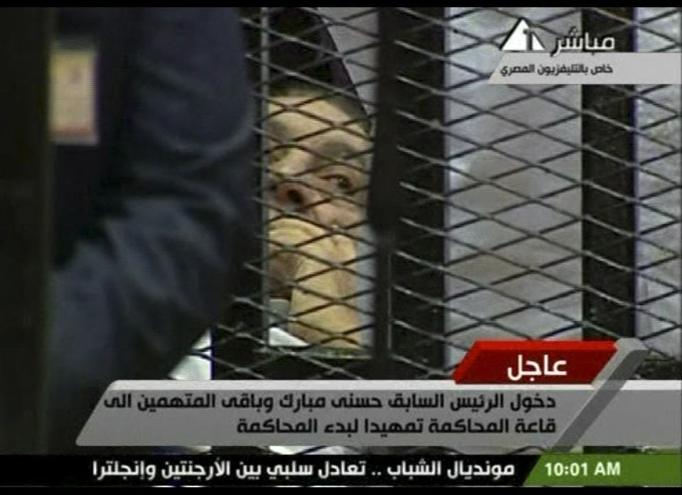 This video image taken from Egyptian State Television shows 83-year-old Hosni Mubarak laying on a hospital bed inside a cage