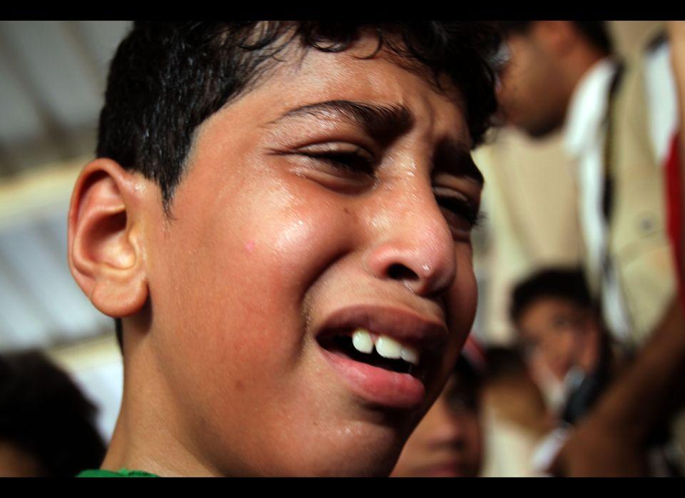 Ahmad al-Shaikh cries Thursday, Sept. 1, 2011, at the funeral in Sitra, Bahrain, for his brother, Ali Jawad Ahmad al-Shaikh,