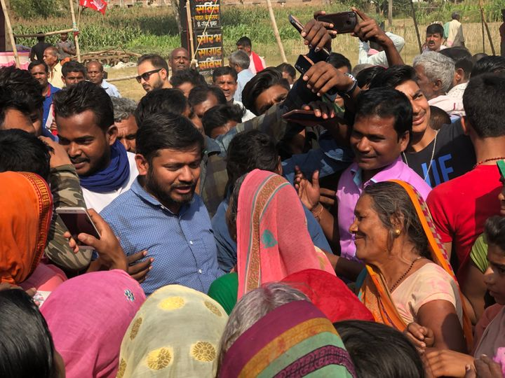 Kanhaiya surrounded by villagers during his campaign