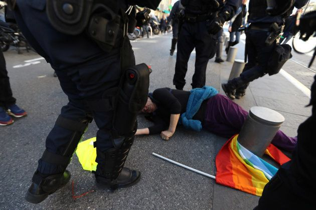 TOPSHOT - French police rush towards Genevieve Legay, an Attac activtist, who collapsed on the ground...