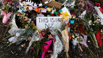 Flower tributes are pictured outside Al-Noor mosque after it was reopened in Christchurch, New Zealand March 23, 2019. REUTERS/Edgar Su