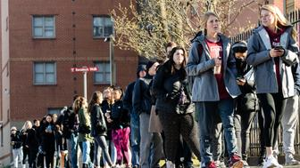 A line of mostly students wait to enter a vaccination clinic amid a mumps outbreak on the Temple University campus in Philadelphia, Wednesday, March 27, 2019. (AP Photo/Matt Rourke)