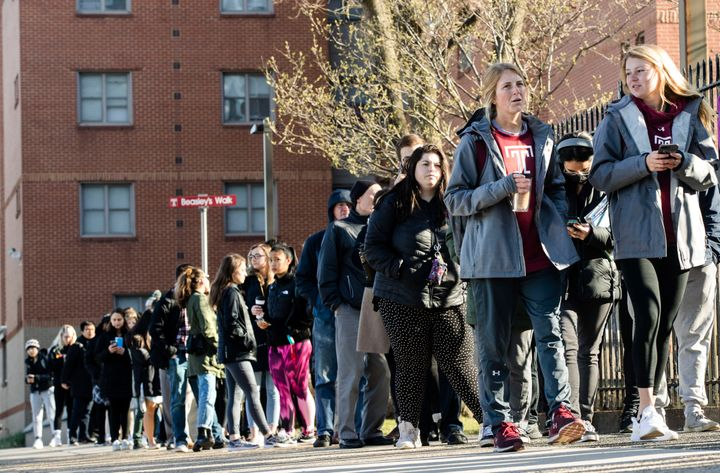 A line of mostly students waits to enter a vaccination clinic on Wednesday amid a mumps outbreak on the Temple University cam