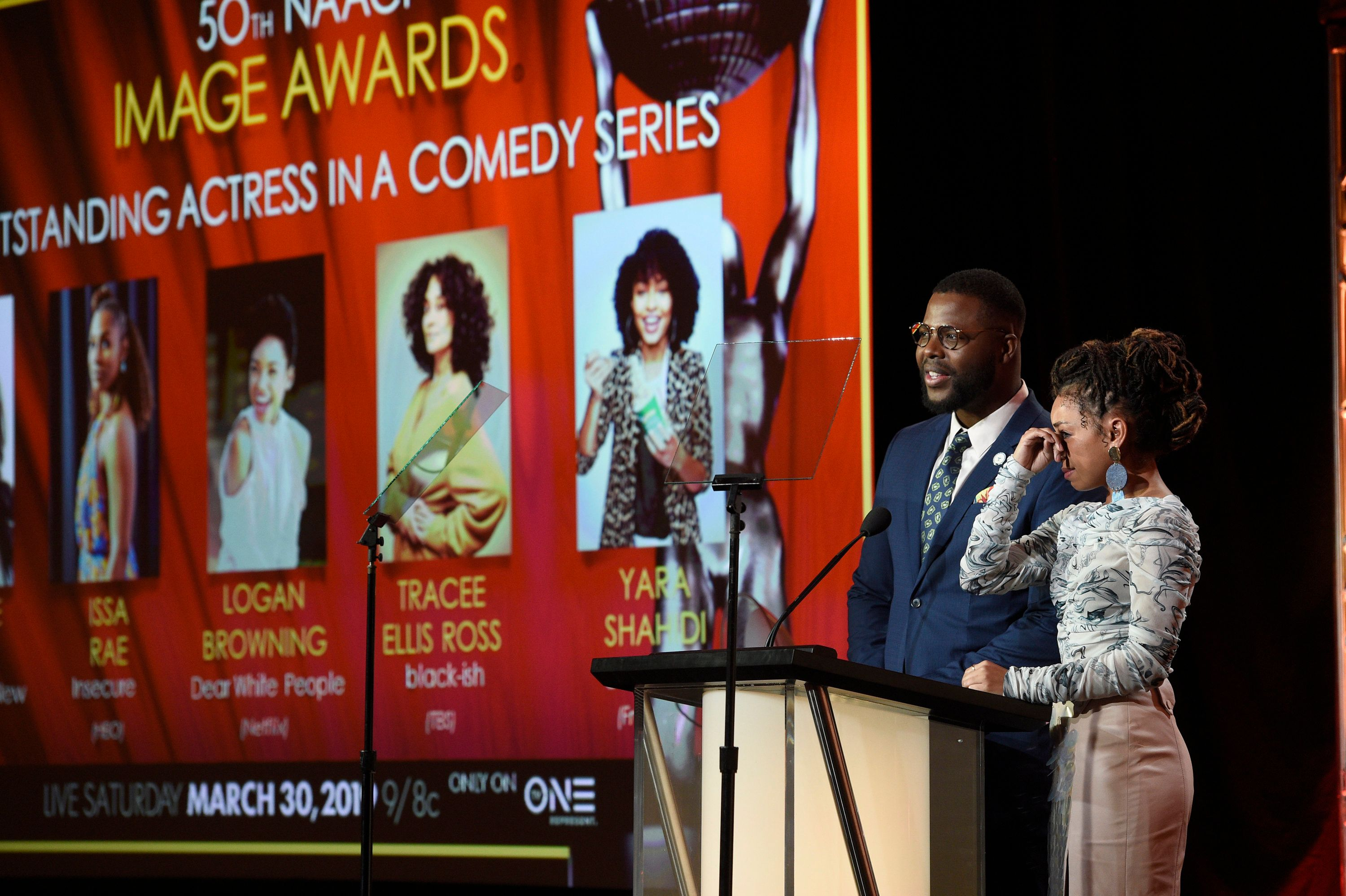 Logan Browning, right, reacts as Winston Duke announces her as a nominee for the 50th annual NAACP Image Awards during TV One's Winter Television Critics Association Press Tour on Wednesday, Feb. 13, 2019, in Pasadena, Calif. (Photo by Chris Pizzello/Invision/AP)