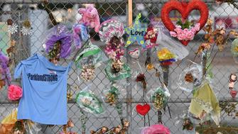 PARKLAND, FL - FEBRUARY 27: A makeshift memorial is seen outside Marjory Stoneman Douglas High School on Tuesday February 27, 2018 in Parkland, FL. A shooting on February 14th at the school left 17 people dead. (Photo by Matt McClain/The Washington Post via Getty Images)