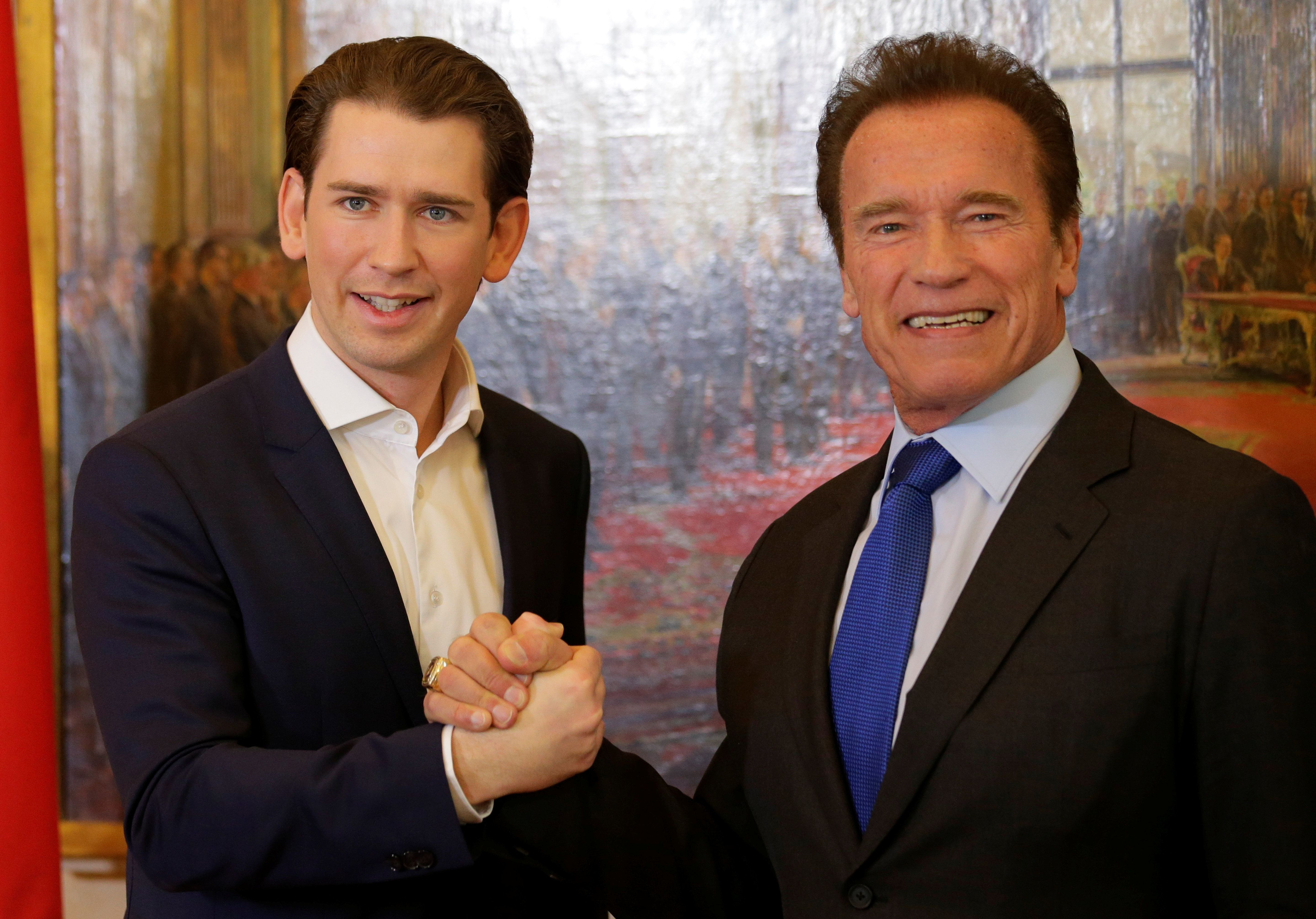 Austrian Chancellor Sebastian Kurz welcomes actor Arnold Schwarzenegger in his office in Vienna, Austria January 24, 2018.  REUTERS/Heinz-Peter Bader