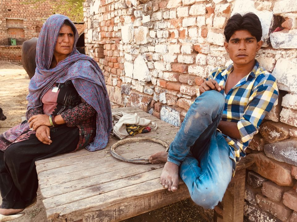 Jaibuna with her son Arif in Jaisinghpur village in