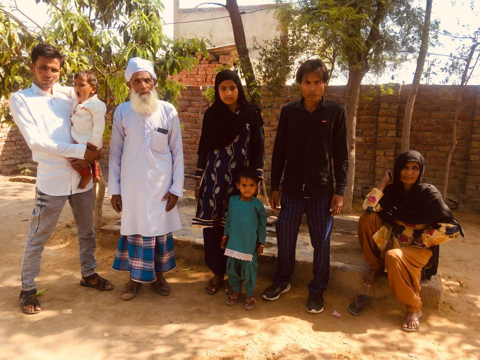 Azmat with his family in Jaisinghpur village in